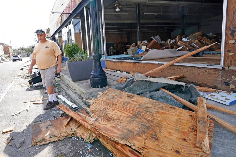 Downtown business owner Pat Ring looks at some of the damage to businesses along Main Street in the aftermath of Hurricane Ida, Monday, Aug. 30, 2021, in Houma, La. (AP Photo/David J. Phillip)