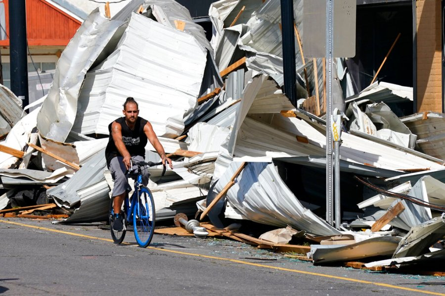 A man rides a bike along Main Street in the aftermath of Hurricane Ida, Monday, Aug. 30, 2021, in Houma, La. (AP Photo/David J. Phillip)