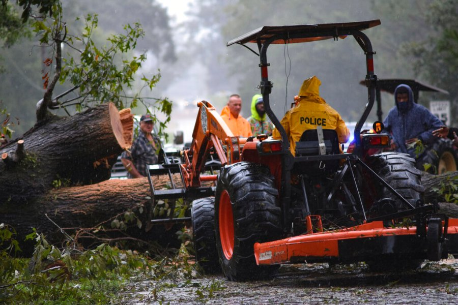 Following Hurricane Ida's destructive path, volunteers and town officials alike in Osyka, Miss., began cleanup efforts to make the roads navigable for first responders and utility workers Monday, Aug. 31, 2021. (Caleb McCluskey/The Enterprise-Journal via AP)