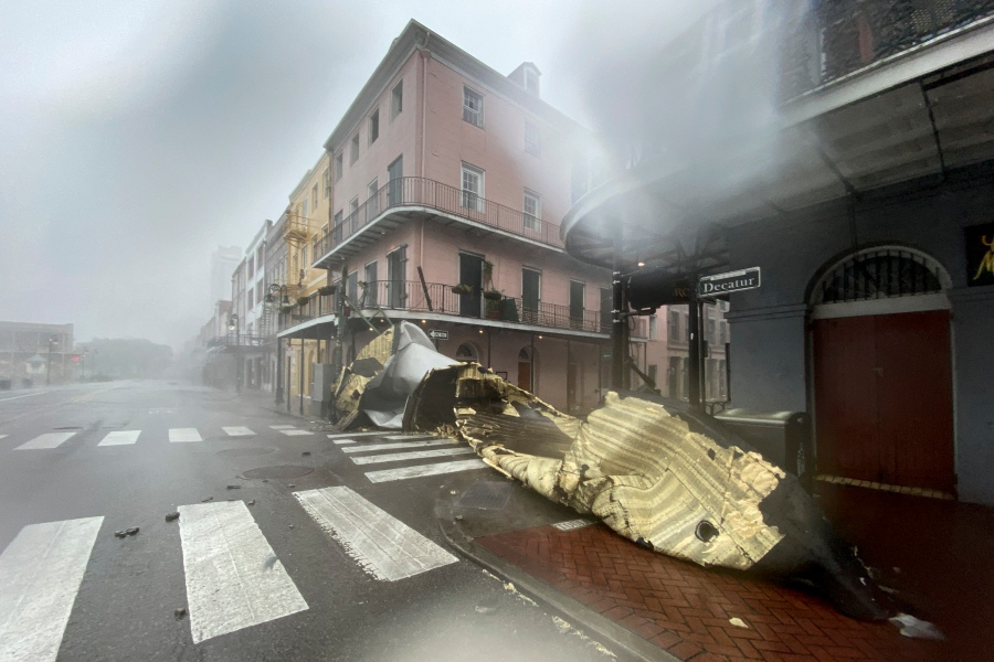 A section of a building's roof is seen after being blown off during rain and winds in the French Quarter of New Orleans, Louisiana on August 29, 2021 during Hurricane Ida. (Photo by PATRICK T. FALLON/AFP via Getty Images)