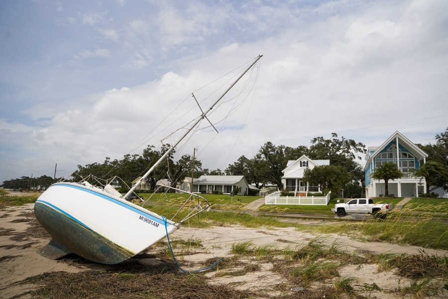 A sailboat sits on the beach after Hurricane Ida passed on August 30, 2021 in Bay St. Louis, Mississippi. Ida made landfall as a Category 4 hurricane yesterday in Louisiana and brought flooding and wind damage along the Gulf Coast. (Photo by Sean Rayford/Getty Images)