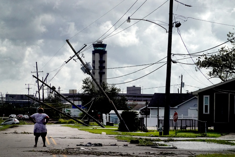 A woman looks over damage to a neighborhood caused by Hurricane Ida on August 30, 2021 in Kenner, Louisiana. Ida made landfall yesterday as a category 4 storm southwest of New Orleans. (Photo by Scott Olson/Getty Images)