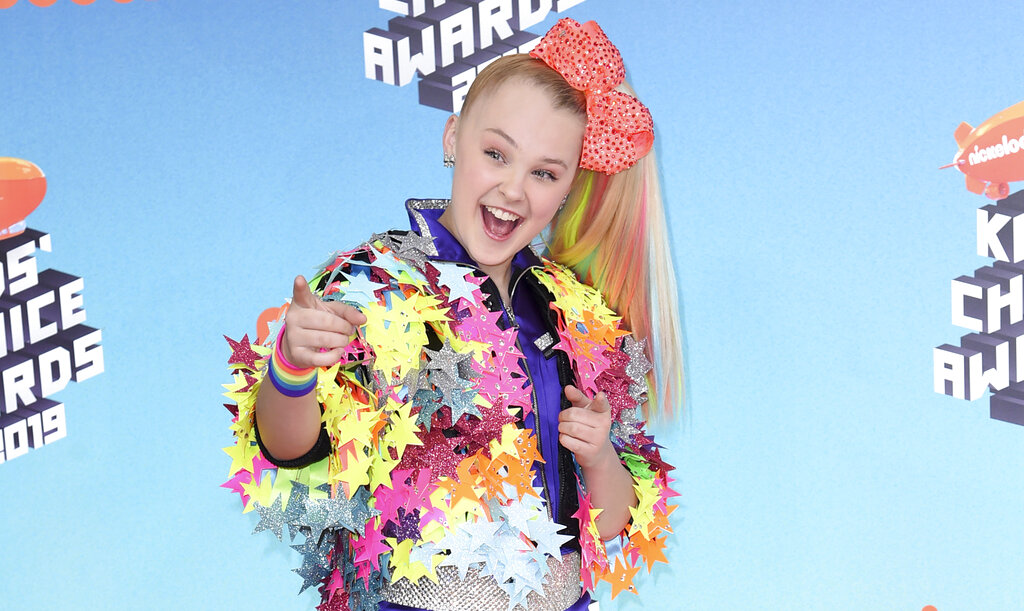 """JoJo Siwa arrives at the Nickelodeon Kids' Choice Awards on March 23, 2019, In Los Angeles. Siwa will compete as part of the first same-sex pairing on """"Dancing With the Stars"""" for the show's upcoming 30th season. (Photo by Richard Shotwell/Invision/AP, File)"""