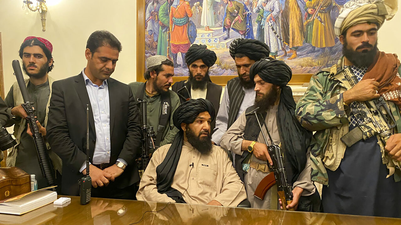Taliban fighters in Afghan presidential palace