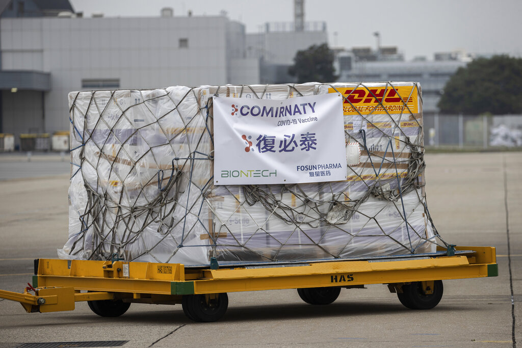 A trolley carrying Pfizer-BioNTech coronavirus vaccines is transported to a warehouse after being unloaded from a Cathay Pacific cargo plane at the Hong Kong International Airport in Hong Kong, Saturday, Feb. 27, 2021. (Jerome Favre/Pool Photo via AP)