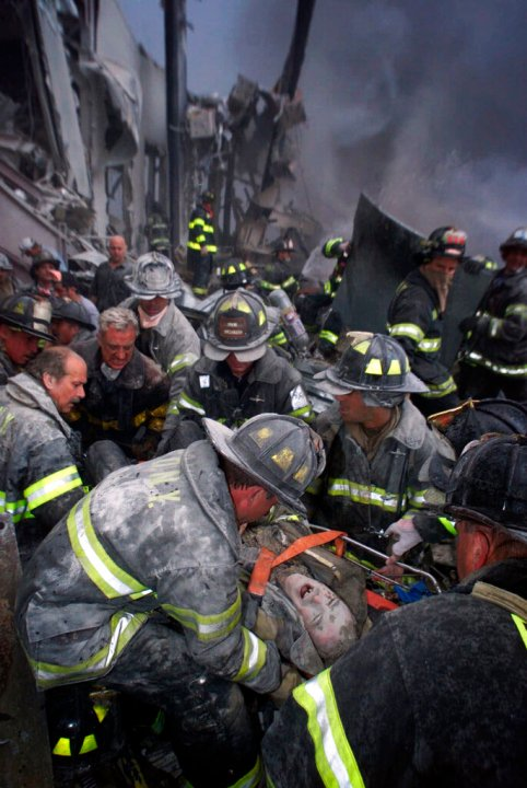 A fireman screams in pain as he is rescued shortly after both towers of New York's World Trade Center collapsed following a terrorist attack, Tuesday, Sept. 11, 2001. (Robert Mecea/Newsday via AP)
