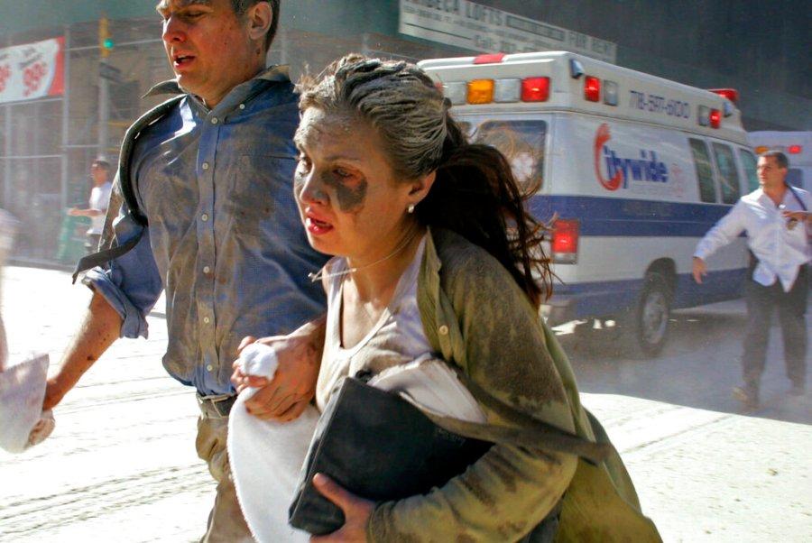 People flee the scene near New York's World Trade Center Tuesday, Sept. 11, 2001. (AP Photo/Diane Bondareff)