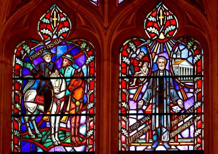 This 2017 file photo shows stained glass windows depicting two Confederate generals at the Washington National Cathedral. Washington National Cathedral has chosen contemporary artist Kerry James Marshall, renowned for his wide-ranging works depicting African-American life, to design new stained-glass windows with themes of racial justice to replace windows with Confederate imagery that were removed from the landmark sanctuary in 2017. (AP Photo/Carolyn Kaster)