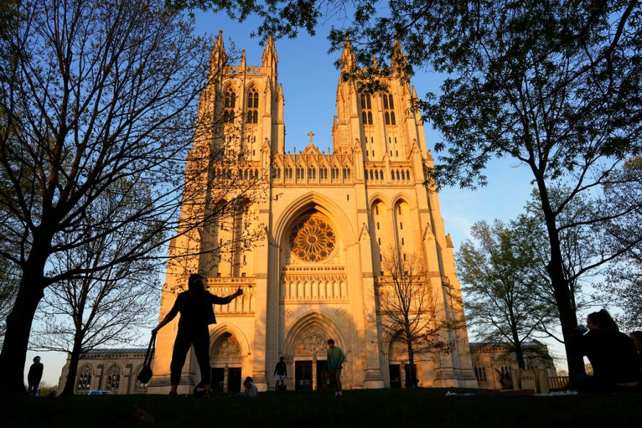 The Washington National Cathedral is seen at sunset. Washington National Cathedral has chosen contemporary artist Kerry James Marshall, renowned for his wide-ranging works depicting African-American life, to design new stained-glass windows with themes of racial justice to replace windows with Confederate imagery that were removed from the landmark sanctuary in 2017. (AP Photo/Carolyn Kaster)