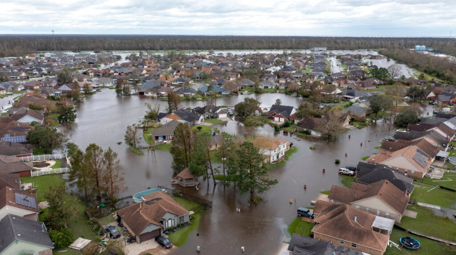 Flooded streets and homes are shown in the Spring Meadow subdivision in LaPlace, La., Hard-hit LaPlace is squeezed between the Mississippi River and Lake Pontchartrain. (AP Photo/Steve Helber)