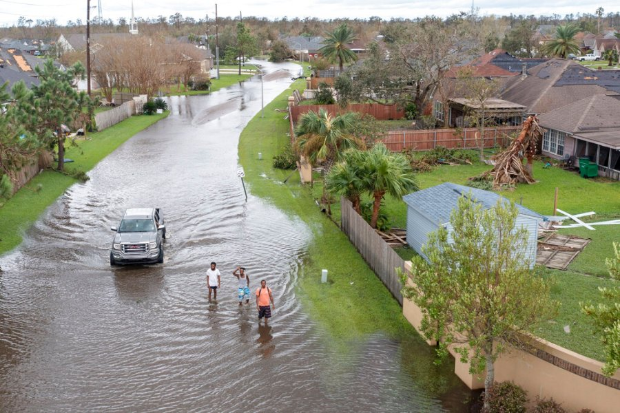 Flooded streets are shown in the Spring Meadow subdivision in LaPlace, La. (AP Photo/Steve Helber)