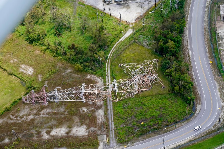 A twisted tower that carried crucial electrical feeder lines to the New Orleans metro area lies collapsed in the aftermath of Hurricane Ida in Bridge City, La. (AP Photo/Gerald Herbert)