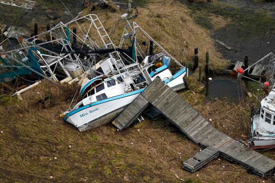 Overturned boats in Lafitte, La., Wednesday, Sept. 1, 2021. (AP Photo/Gerald Herbert)