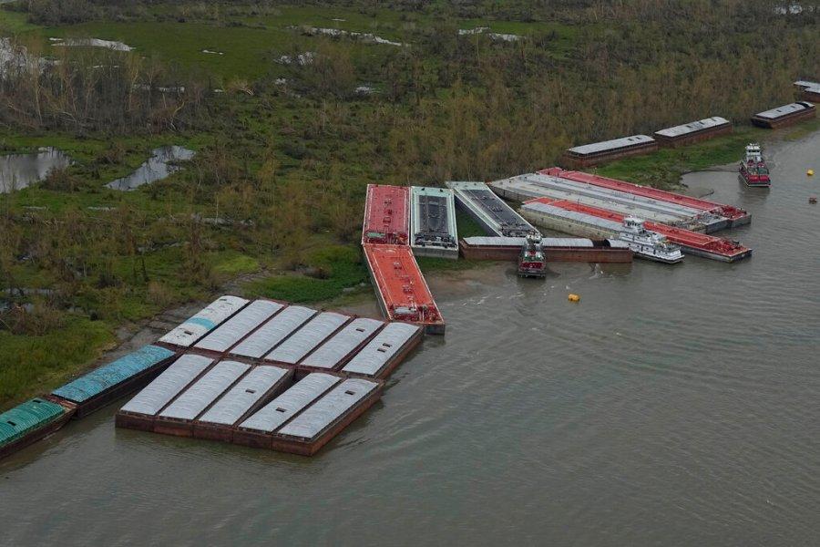 Damaged barges in St. Charles Parish, La. (AP Photo/David J. Phillip)