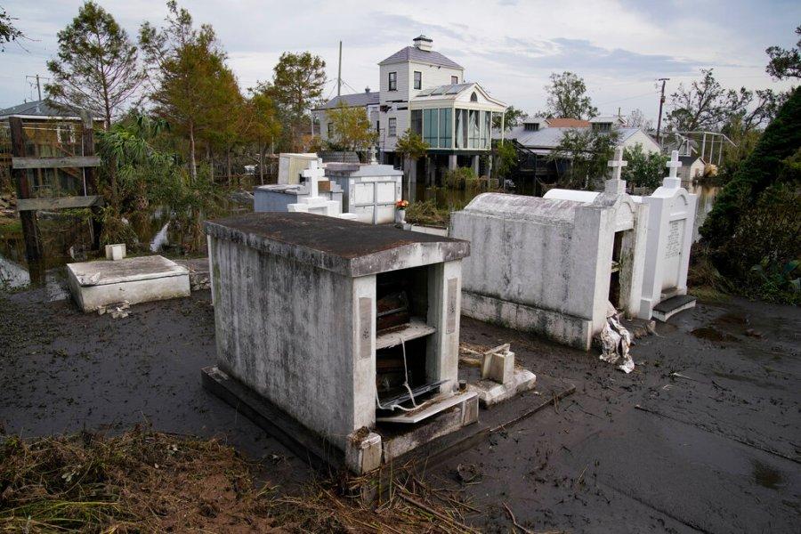 Flood damaged above-ground tombs at a graveyard in Lafitte, La. (AP Photo/John Locher)