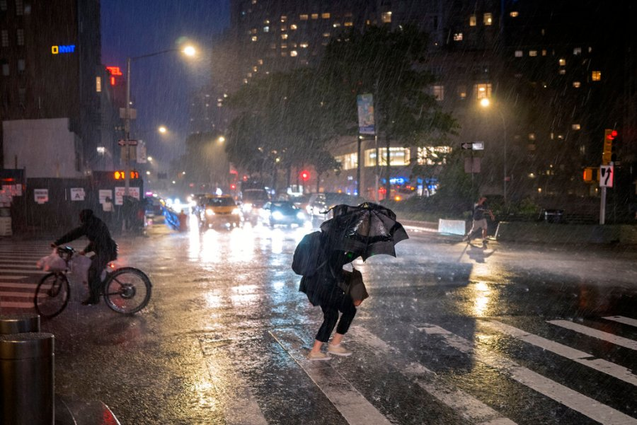 Pedestrians take cover near Columbus Circle in New York as the remnants of Hurricane Ida remained powerful while moving along the Eastern seaboard. (AP Photo/Craig Ruttle)