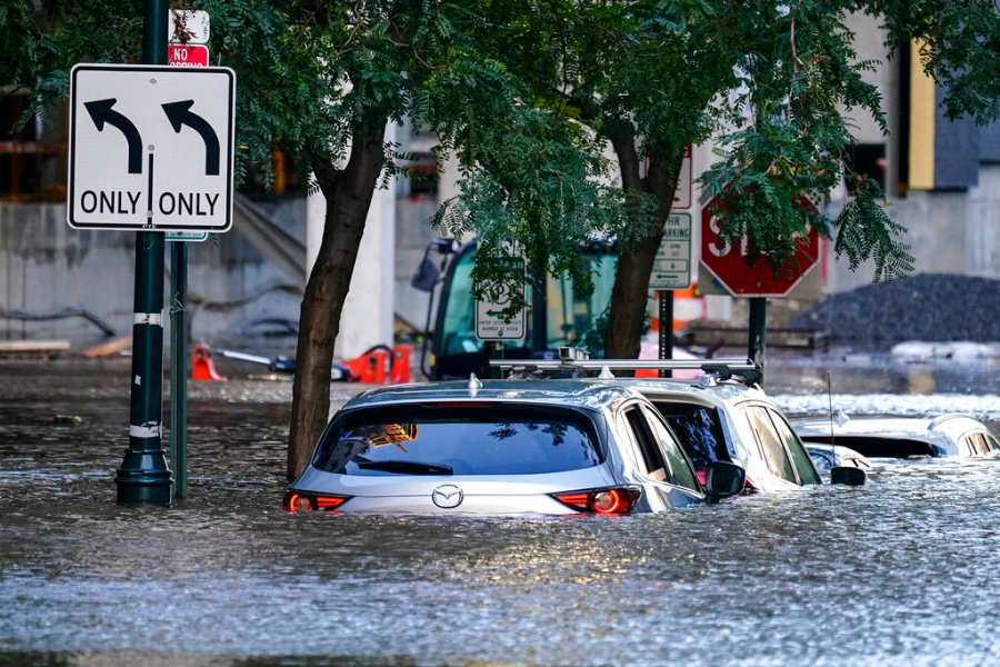 Vehicles are under water during flooding in Philadelphia in the aftermath of downpours and high winds from the remnants of Hurricane Ida that hit the area. (AP Photo/Matt Rourke)