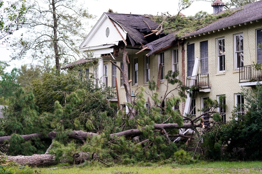 A home is shown severely damaged by trees downed by Hurricane Ida in Covington, Louisiana. (Photo by Sean Rayford/Getty Images)