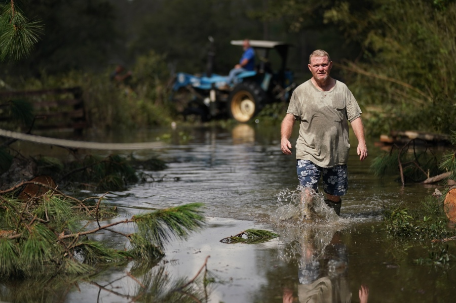 Russell Threeton, a strawberry farmer, walks through floodwater after Hurricane Ida in Springfield, Louisiana. (Photo by Sean Rayford/Getty Images)