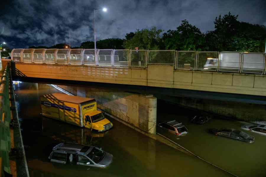 Floodwater surrounds vehicles following heavy rain on an expressway in Brooklyn, New York as flash flooding and record-breaking rainfall brought by the remnants of Storm Ida swept through the area. (Photo by ED JONES/AFP via Getty Images)