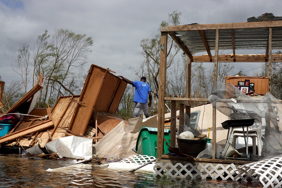 Alonzo Lewis rescues items from his mother's home after it was destroyed by Hurricane Ida. (Photo by Scott Olson/Getty Images)