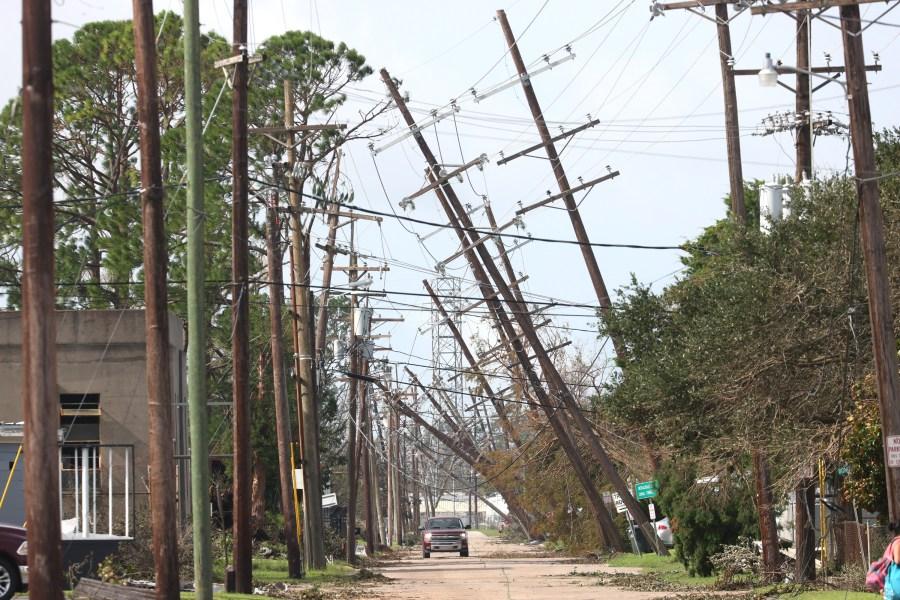 Utility poles lean over a street following Hurricane Ida in Houma, Louisiana. (Photo by Scott Olson/Getty Images)
