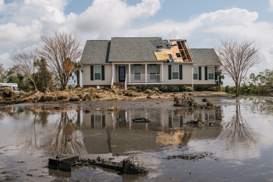 Floodwater surrounds a house in Jean Lafitte, Louisiana. (Photo by Brandon Bell/Getty Images)