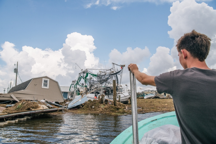 Jareth Palmisano steers a boat through the Jean Lafitte Harbor in Jean Lafitte, Louisiana. (Photo by Brandon Bell/Getty Images)