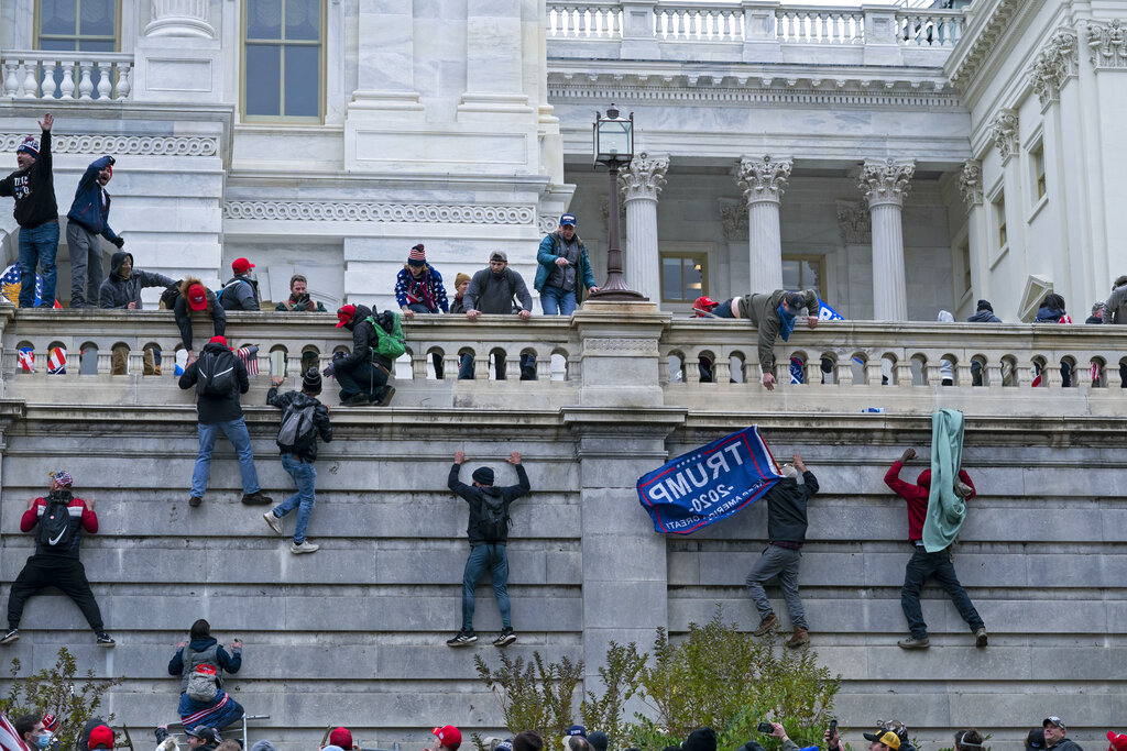 Rioters climb the west wall of the the U.S. Capitol in Washington on January 6th. (AP Photo/Jose Luis Magana, File)