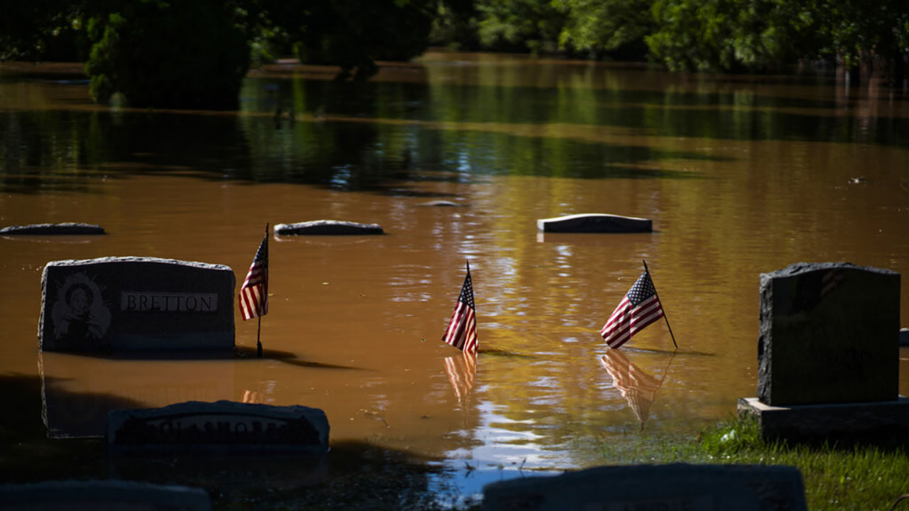 Headstones at a flooded cemetery