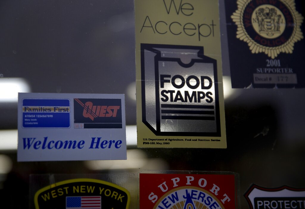 A supermarket displays stickers indicating they accept food stamps in West New York, N.J. The Biden administration has approved a significant and permanent increase in the levels of food stamp assistance available to needy families—the largest single increase in the program's history. Starting in October 2021, average benefits for food stamps (officially known as the SNAP program) will rise more than 25 percent above pre-pandemic levels. (AP Photo/Seth Wenig, File)