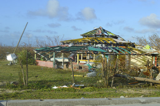 In this Thursday, Sept. 7, 2017, photo, damage is left after Hurricane Irma hit Barbuda. Hurricane Irma battered the Turks and Caicos Islands early Friday as the fearsome Category 5 storm continued a rampage through the Caribbean that has killed a...